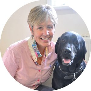 Helen Sanderson with a dog
