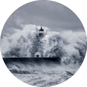 Lighthouse with crashing storm waves