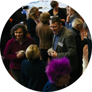 Group at an event standing and chatting