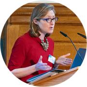 Dr Alexandra Pitman speaking at the MMI symposium