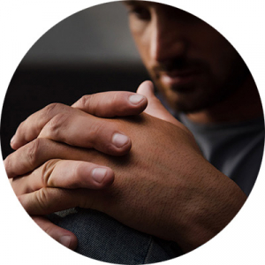 close up of man with hands folded
