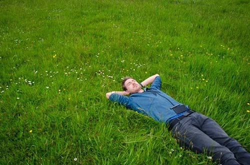 Ashton Hollwarth's image of a man relaxing in the grass